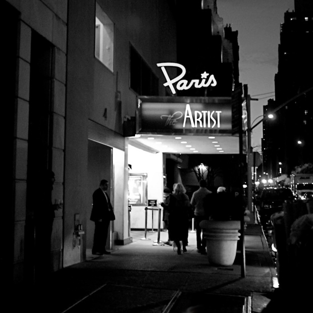 Black and white photo of the Paris Theatre New York City showing The Artist.